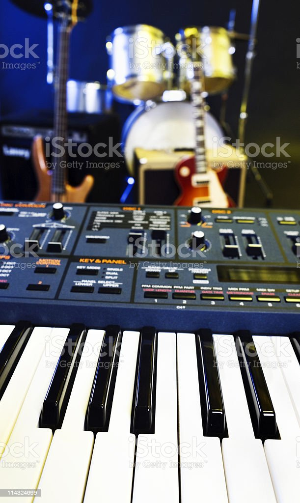 Synthesizer, guitar and drums stock photo