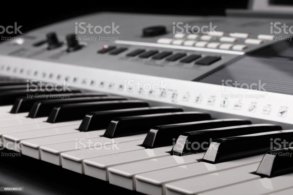 synthesizer keyboard with knobs and controllers stock photo
