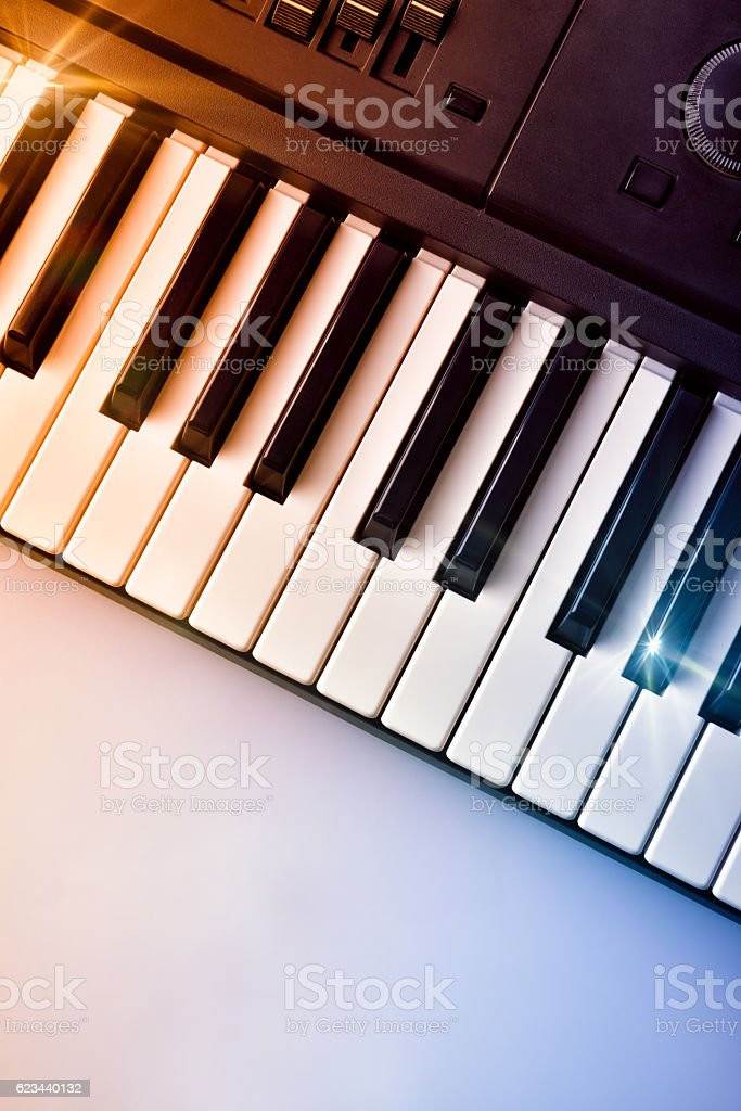 Synthesizer keyboard with shine and blue red gradient top view stock photo