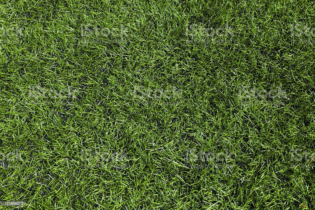 Synthetic green grass football pitch stock photo