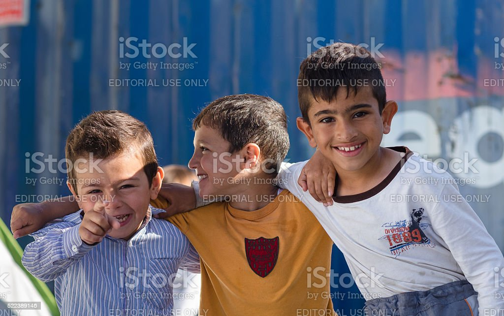 Syrian boys hugging in the refugee camp stock photo