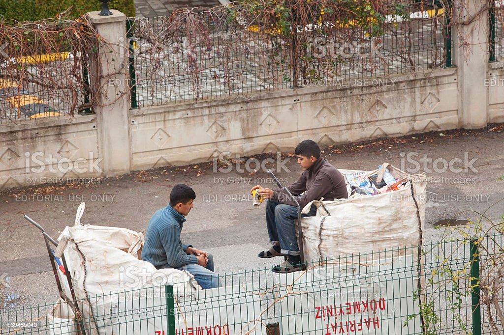 Syrian Childs collecting garbage on Antalya streets stock photo