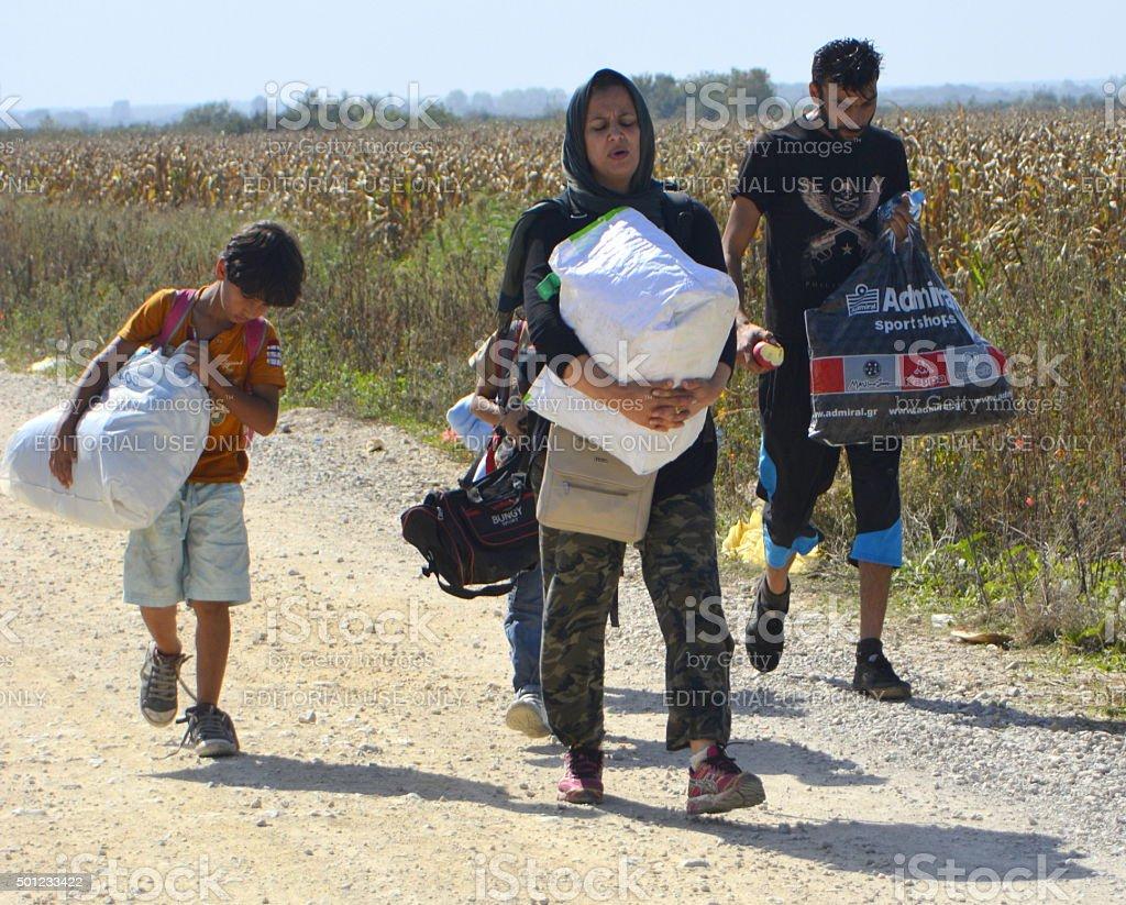 Syrian family going towards European Union states stock photo