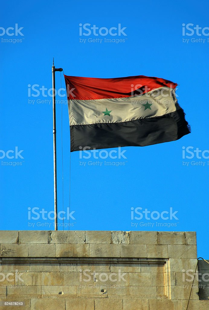 Syrian flag and bullet marks stock photo