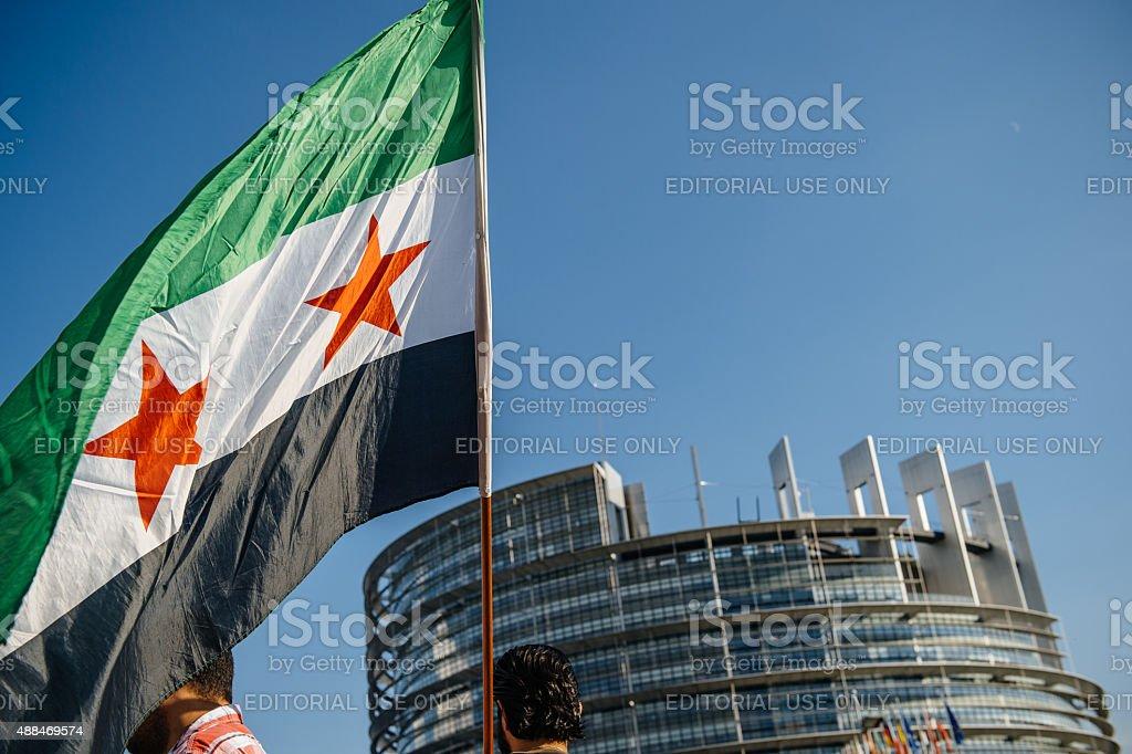 Syrian flag over European Parliament building stock photo