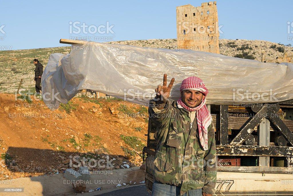 Syrian man flashing victory sign at Turkey border royalty-free stock photo