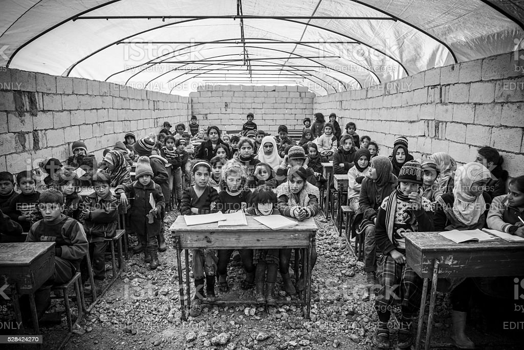 Syrian refugee children in school at IDP camp (Atmeh, Syria) stock photo