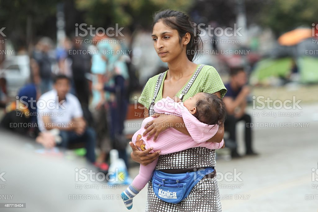 Syrian refugee woman with child in Belgrade stock photo
