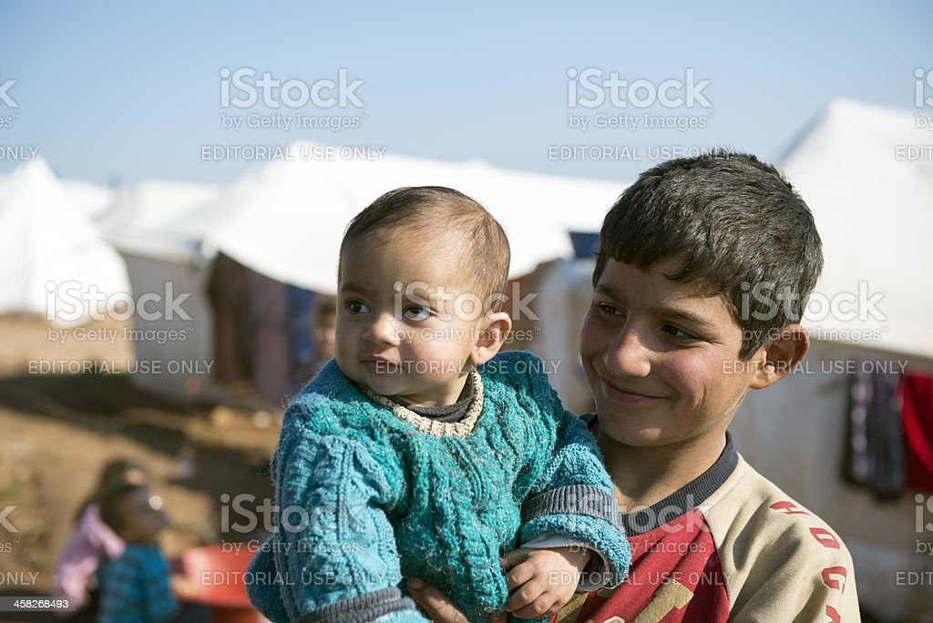 Syrian refugees at displaced persons camp stock photo