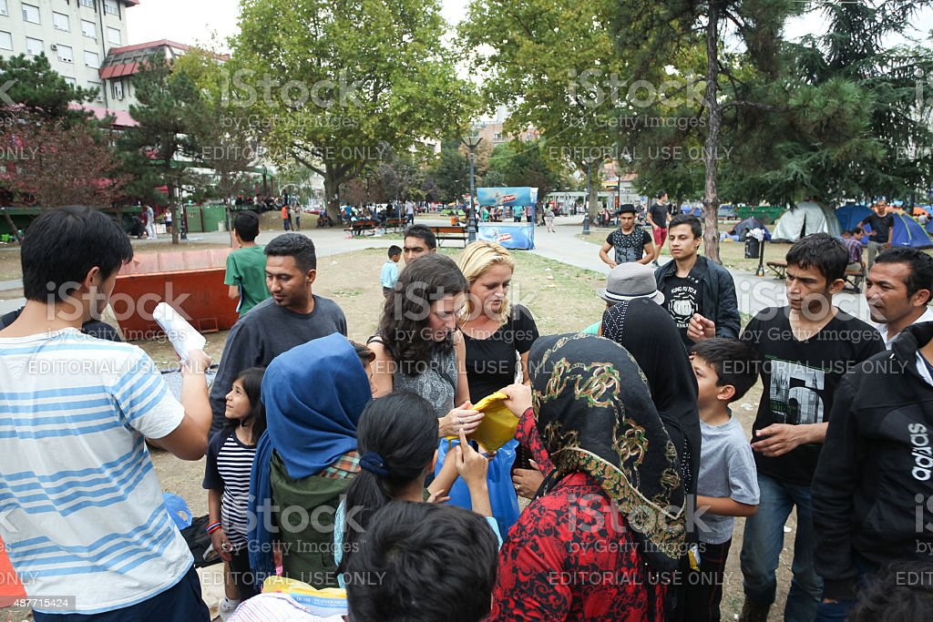 Syrian refugees receiving help stock photo