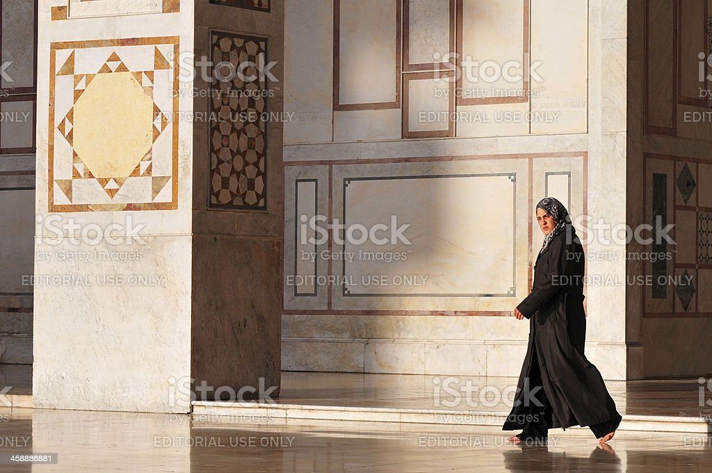 Syrian woman in Damascus' Umayyad Mosque royalty-free stock photo