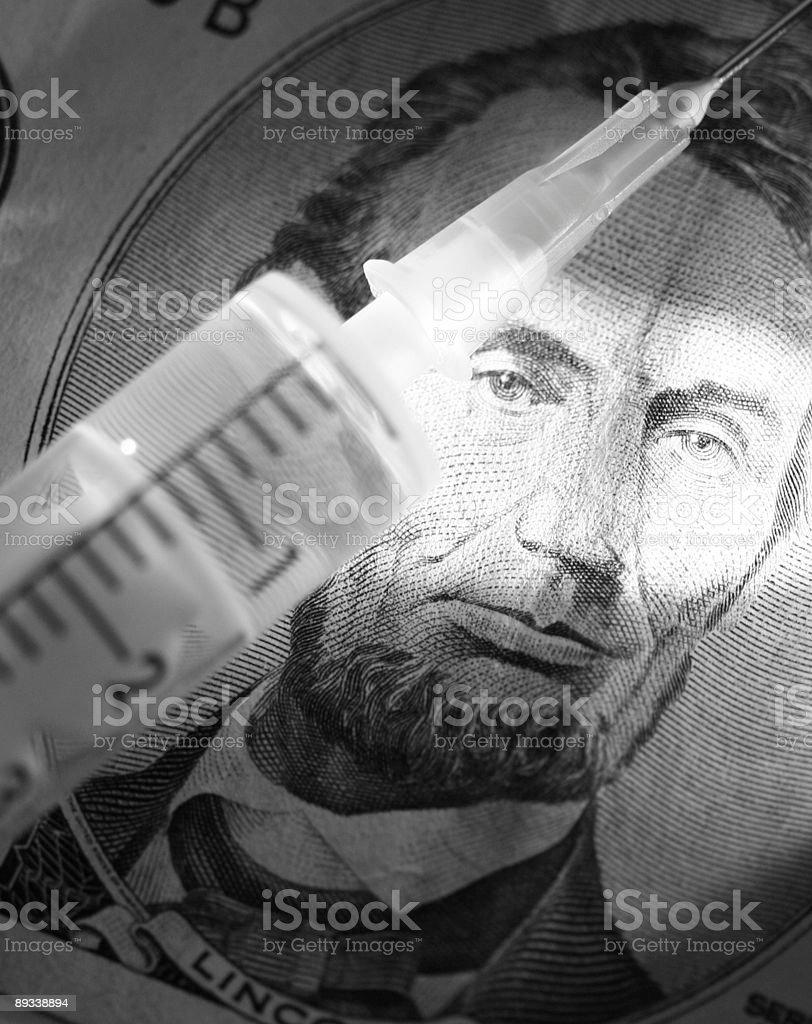 syringe and bill royalty-free stock photo
