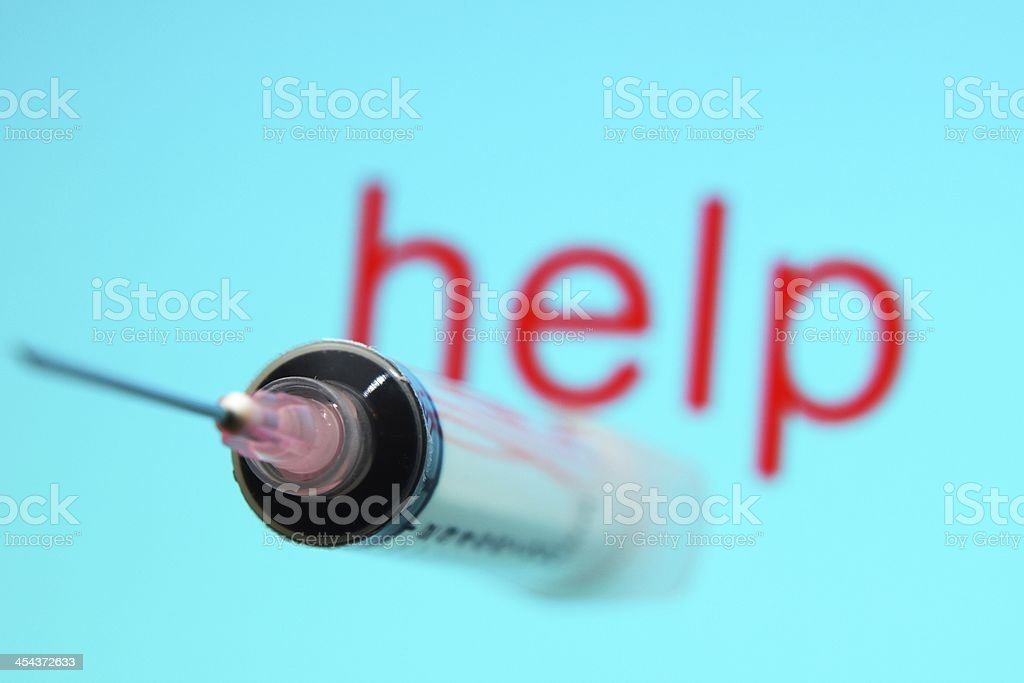 Syringe and help text royalty-free stock photo