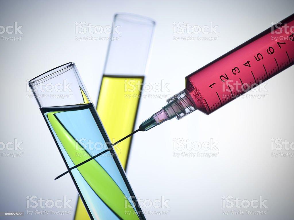 Syringe and test tubes royalty-free stock photo