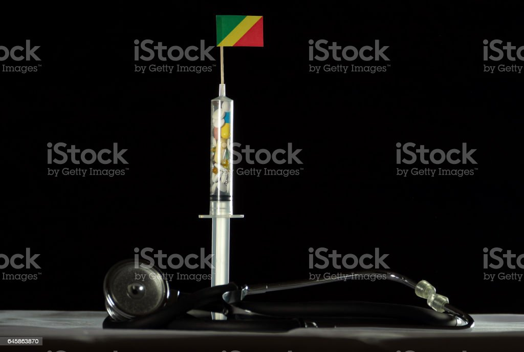 Syringe filled with drugs injecting the Republic of Congo flag stock photo