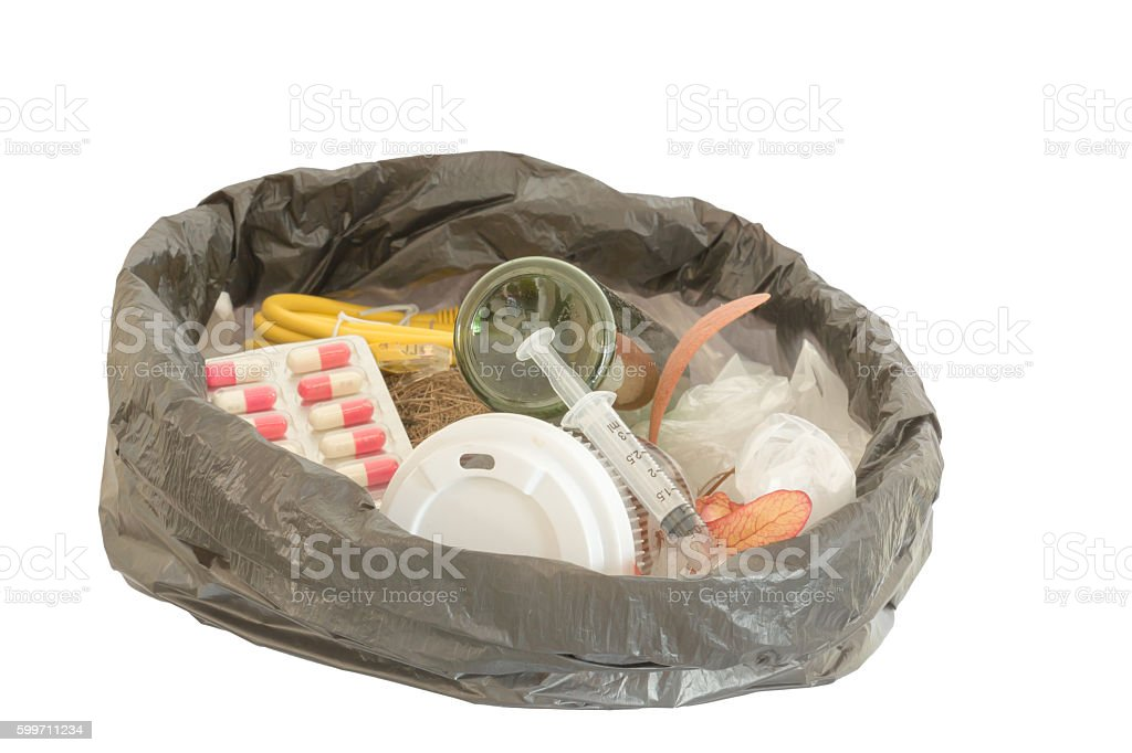 syringe in hazardous waste bag. stock photo