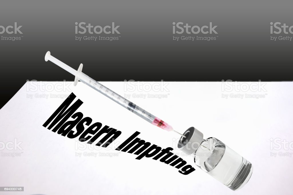 Syringe is filled with vaccine for measles vaccination. stock photo