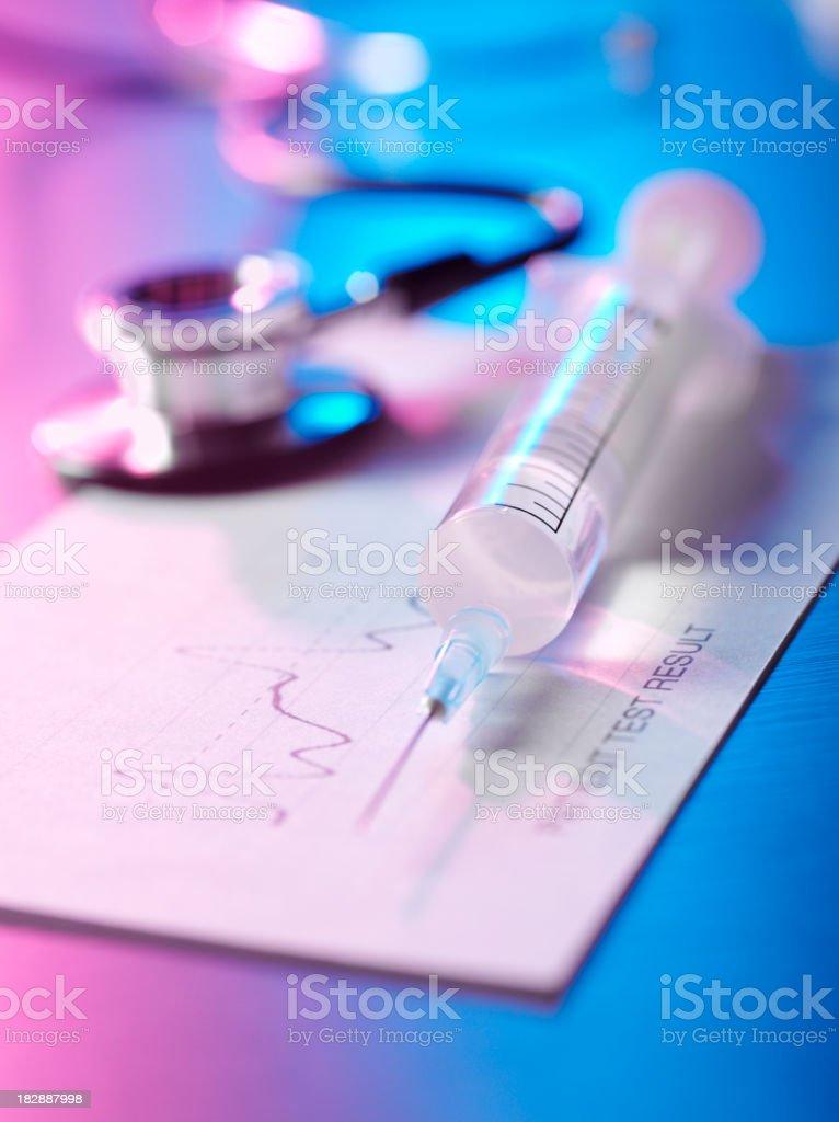 Syringe with Stethoscope and Chart royalty-free stock photo