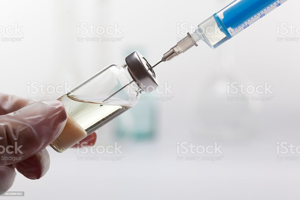 syringe with vial stock photo