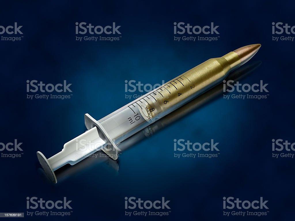 Syringe-bullet stock photo
