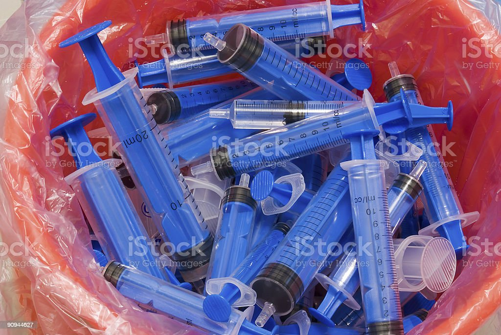 Syringes in recycle bin royalty-free stock photo