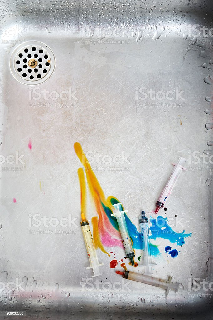 Syringes in the kitchen sink! stock photo