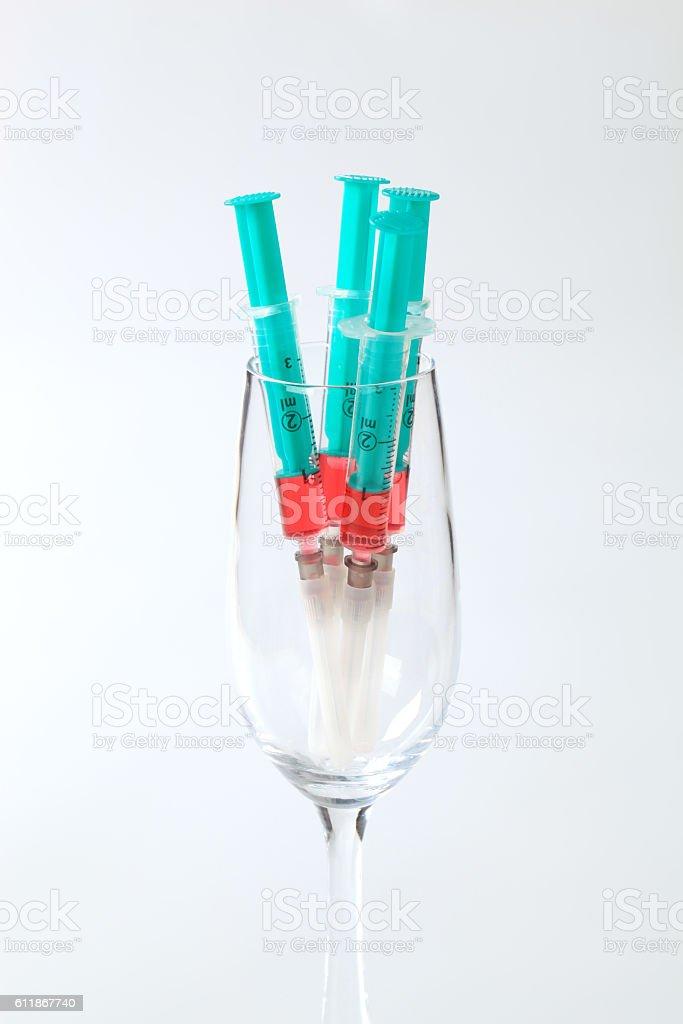Syringes with blue liquid stock photo