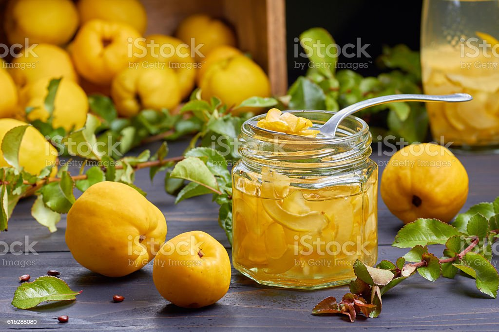 Syrup of japanese quince on fresh fruits background stock photo