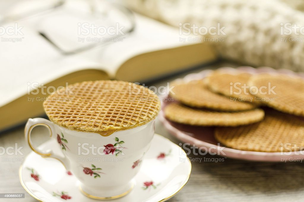 Syrup waffle warming on top of a teacup royalty-free stock photo