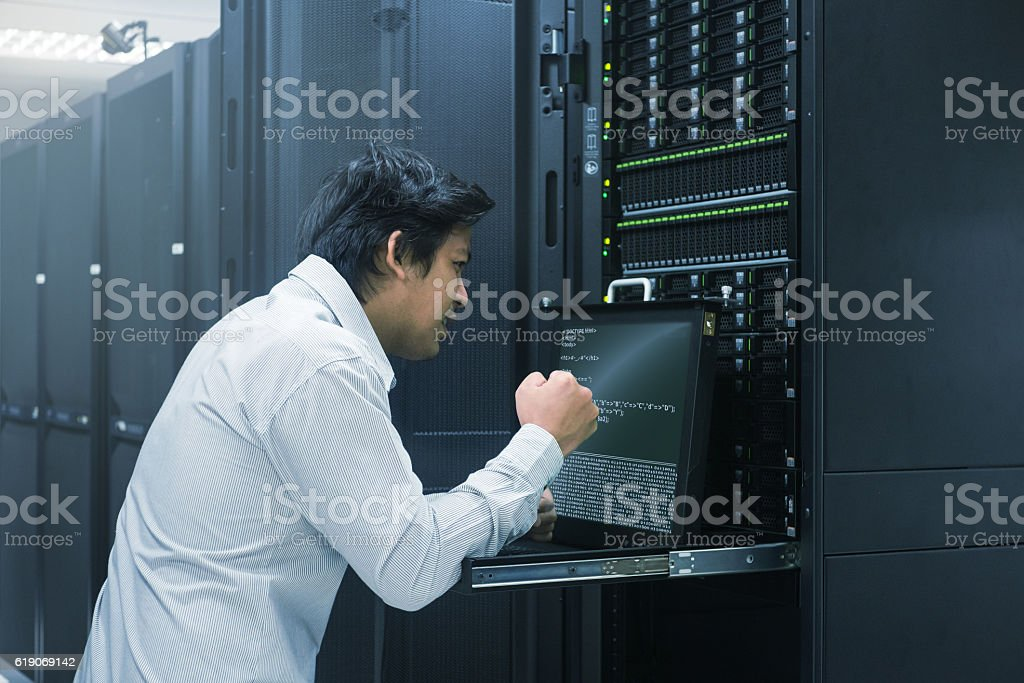 System administrator finish working in data center stock photo