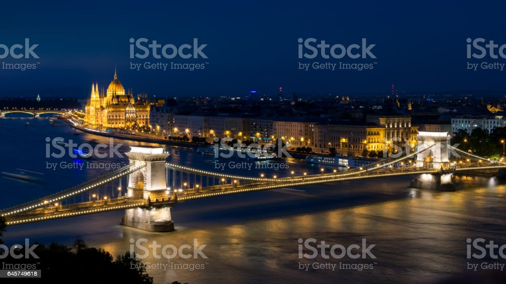 Széchenyi Chain Bridge by dusk with the parliament stock photo