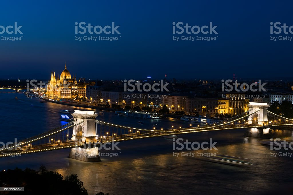Széchenyi Chain Bridge by dusk with the parliament with sky stock photo