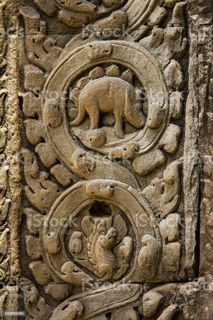 Ta Prohm temple and Bas relief  wall dinosaur stock photo