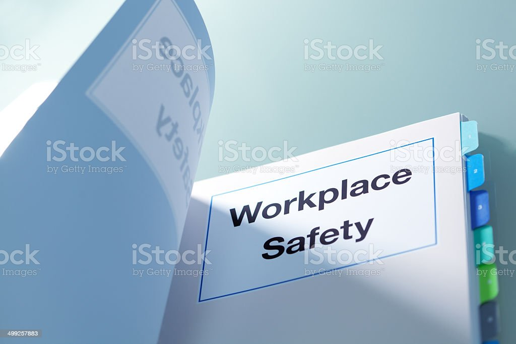 Tabbed manual titled 'Workplace Safety' stock photo