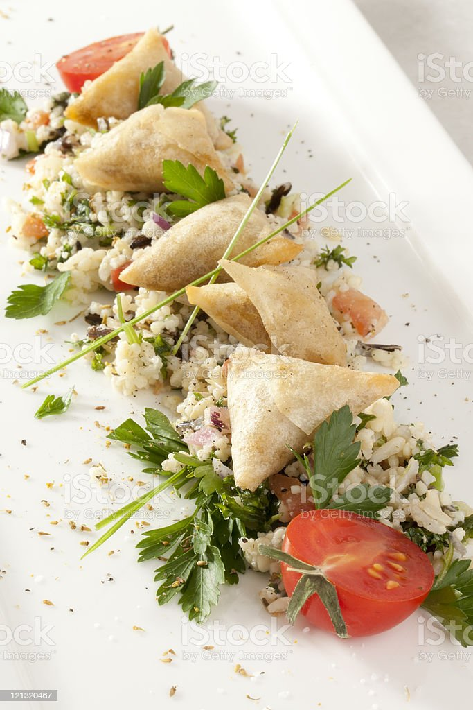 Tabbouleh and cheese puffs stock photo