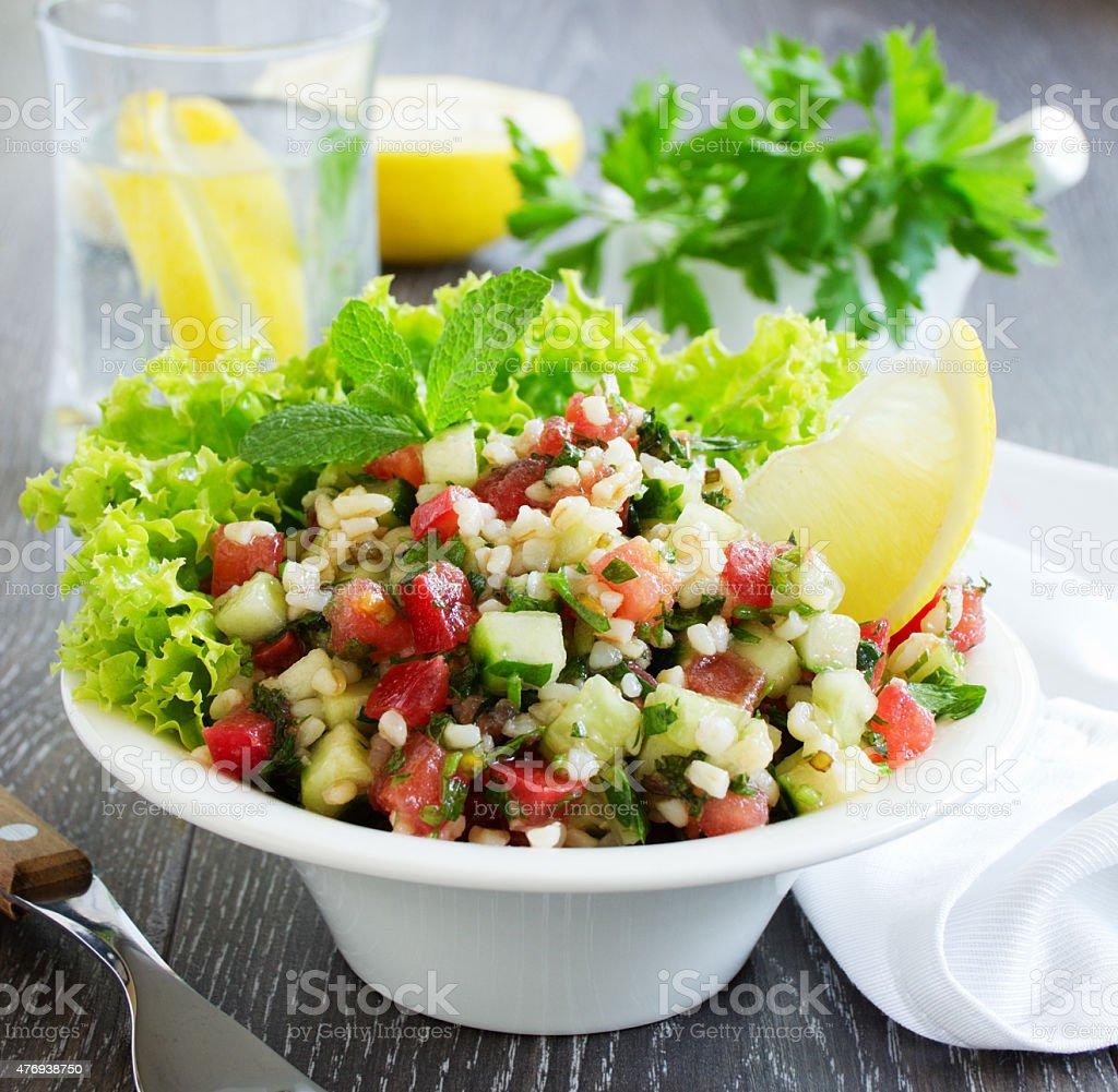 Tabbouleh salad with bulgur and parsley. stock photo