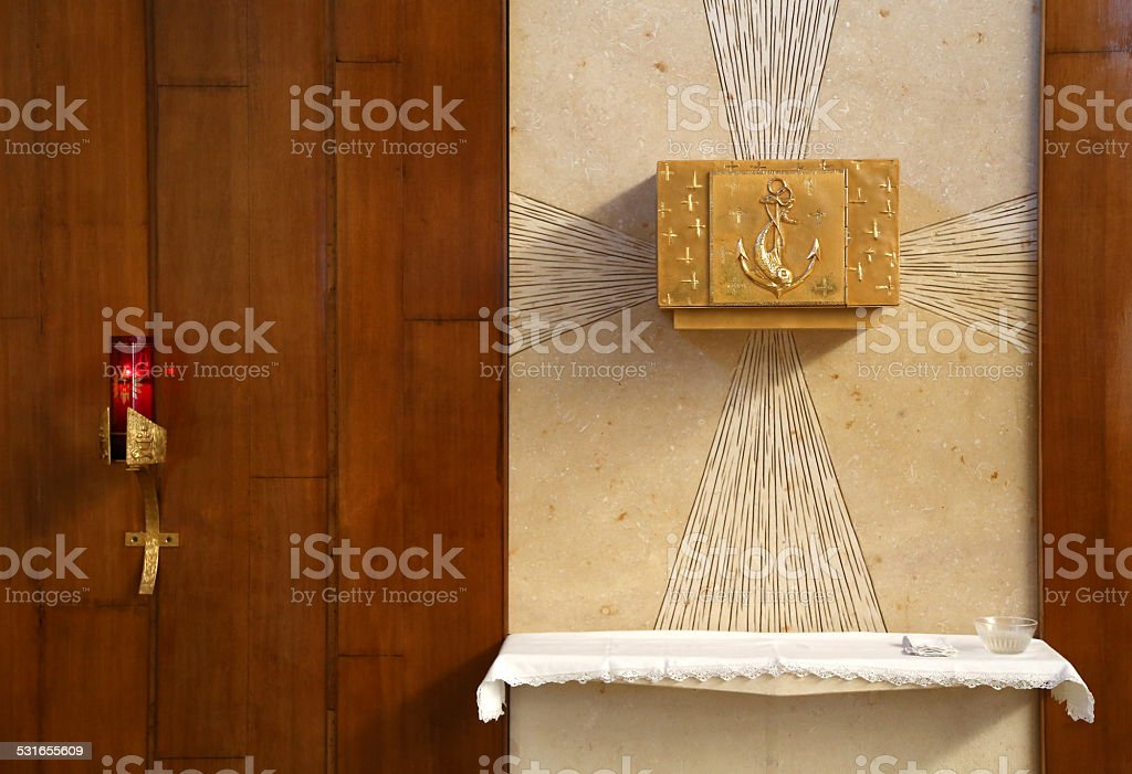 Tabernacle with consecrated hosts in the Church stock photo
