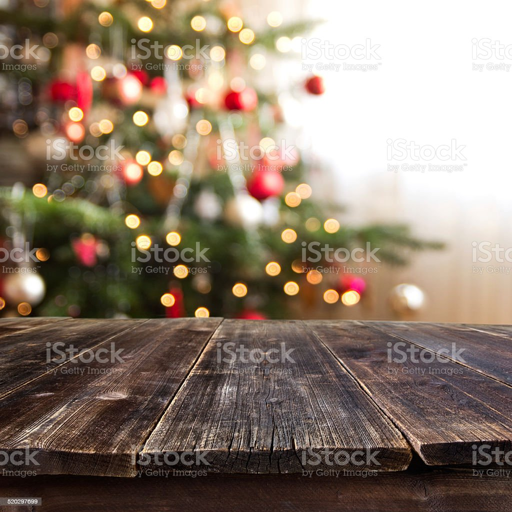 table against christmas tree stock photo