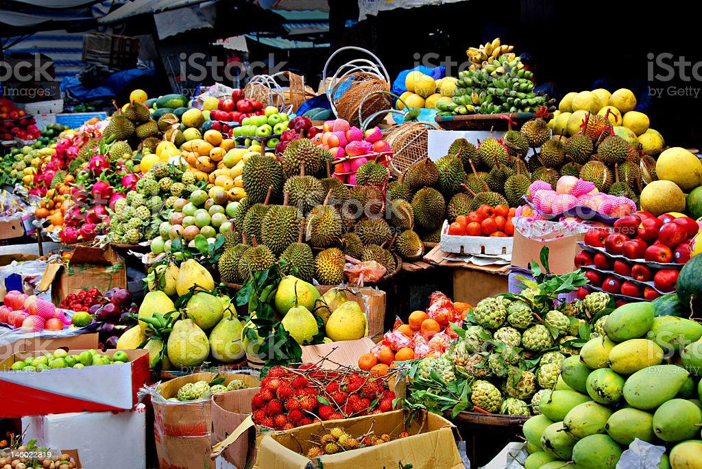 Table and boxes filled with a variety of exotic fruits stock photo