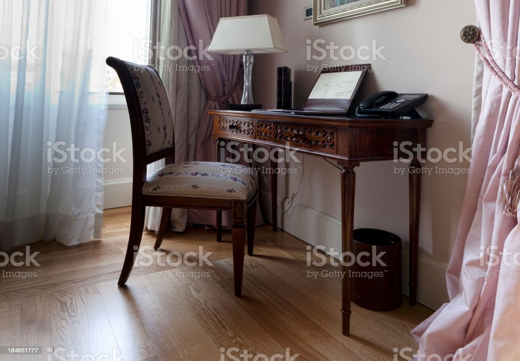 table and chair by the window royalty-free stock photo