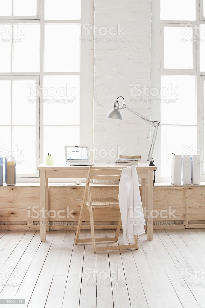 Table And Chair In Loft Apartment stock photo