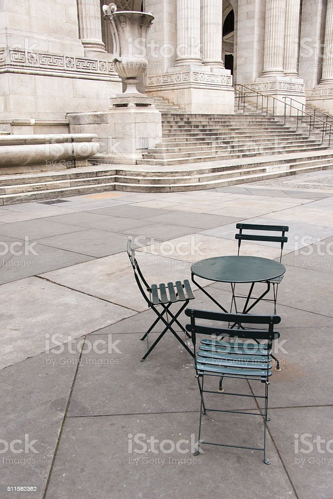 Table and chairs at the New York Public Library stock photo