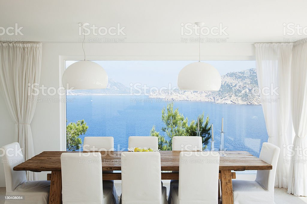Table and chairs in modern dining room royalty-free stock photo