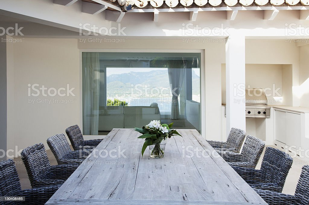 Table and chairs on patio royalty-free stock photo