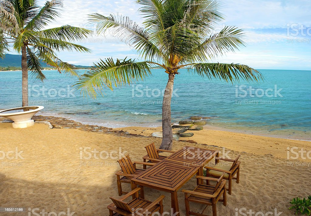 Table and chairs on the beach royalty-free stock photo