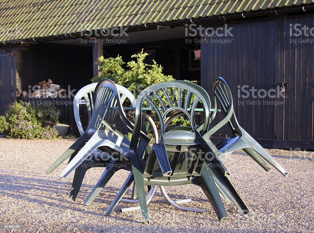 Table and chairs outside cafe royalty-free stock photo