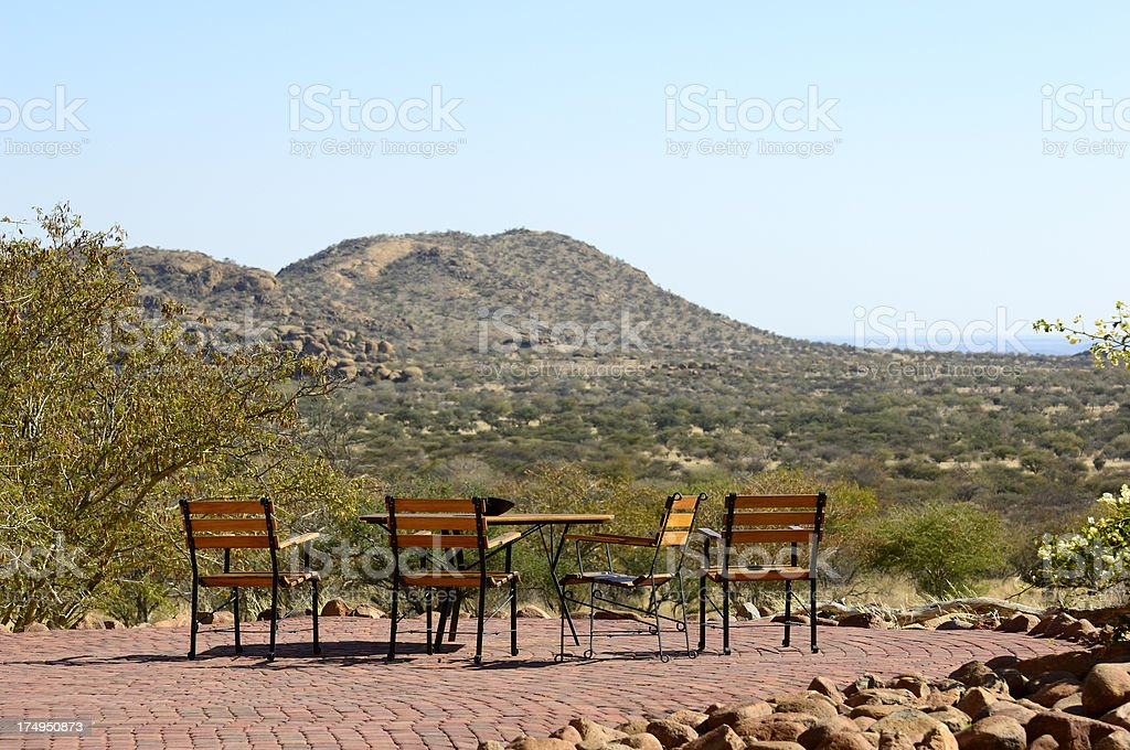 Table and chairs with typical landscape in background stock photo
