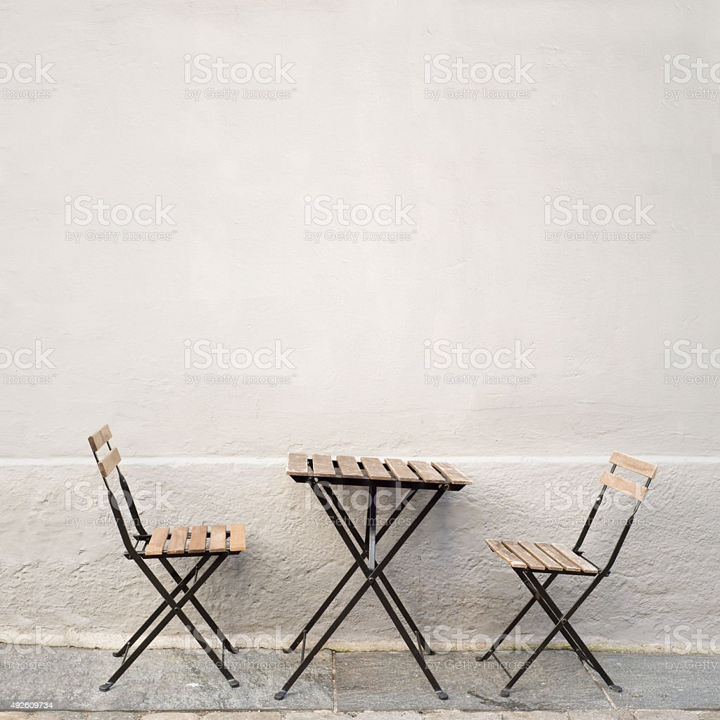 table and two chairs near the wall stock photo