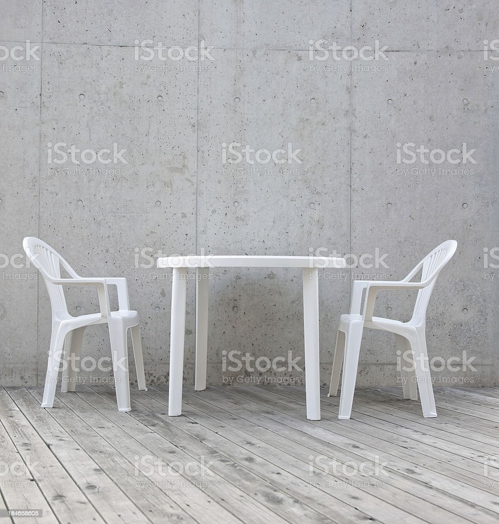 Table and two chairs stock photo