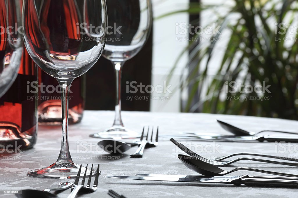 A table at a restaurant set with cutlery and glasses stock photo